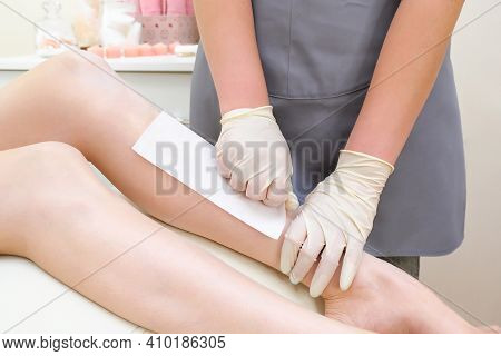 Wax Depilation Of Legs, Depilation Of A Young Woman. Smooth Skin Care
