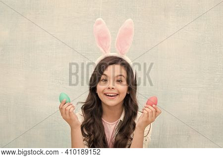 Playful Child With Dyed Eggs. Meet Spring Holiday. Girl Little Child Easter Bunny Accessory. Shoppin