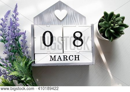 Wooden Calendar March 08 On A White Background Close Up