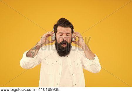 Hearing Problem. Bearded Man Headphones. Modern Wireless Headphones. Dance Music Tracks. Ears Health