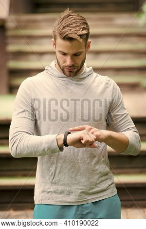 Monitoring Heart Rate From Your Wrist. Athletic Man Check Watch. Handsome Athlete Use Smart Watch. F