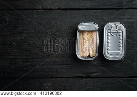 Canned Mackerel Fillets In Tin Set, In Tin Can, On Black Wooden Table Background, Top View Flat Lay,