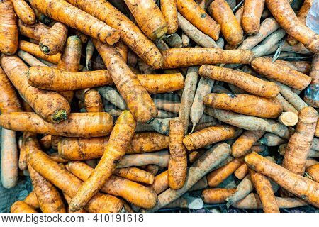 Fresh Carrots On The Counter Of A Grocery Store In Supermarket. Dirty Carrots In Store. Carrots On T