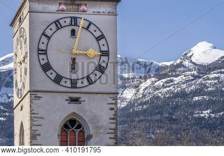 Clock On The Bell Tower Of The Reformed Church Of St. Martin In Chur, Switzerland