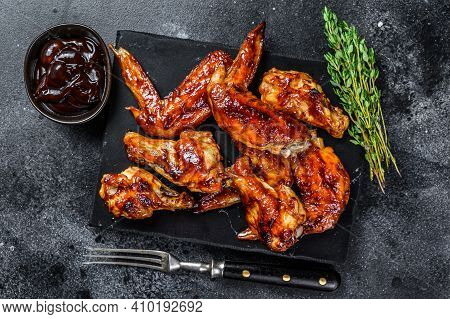 Hot Barbecue Chicken Wings With Sauce Bbq. Black Background. Top View