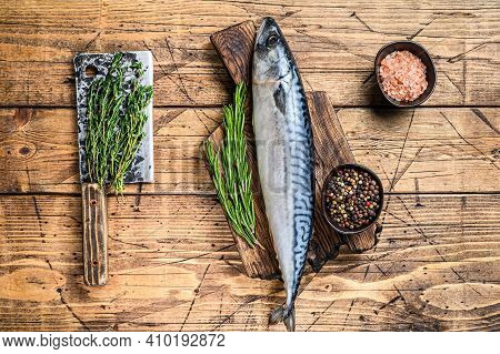 Raw Saltwater Fish Mackerel On A Wooden Cutting Board With A Thyme. Wooden Background. Top View