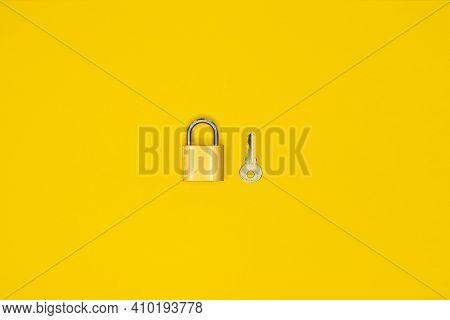 Key And Padlock, Lock On Yellow Background