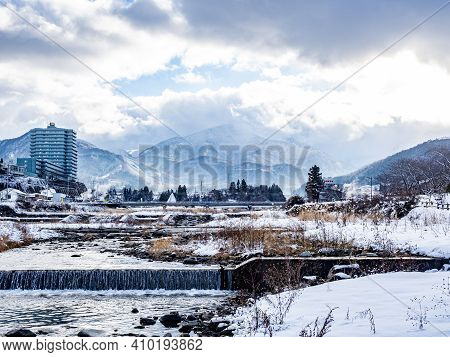 The Mountains Of The Shiga Kogen In The Japanese Alps As Seen From The Yomase River In Yamanouchi, N