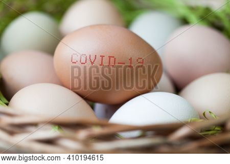 Basket Full Of Eggs, With Covid-19 Stamped Onto One, Coronavirus Global Pandemic Interrupting Easter