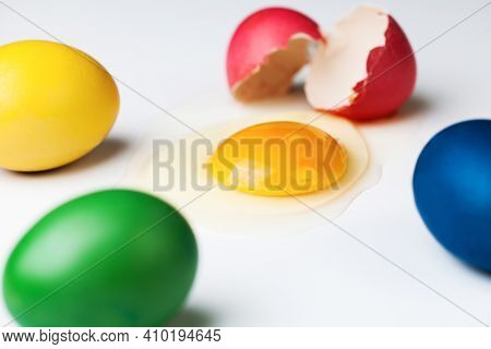 Colorful Painted Eggs With One Cracked, Egg White And Yolk Spilled Around, Coronavirus Covid-19 Coro
