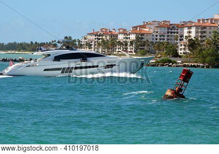 Luxury White Motor Yacht Heading Toward Port Of Miami Cruising Through Government Cut Against Aa Bac