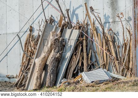 Scraps Of Wood And Debris Leaning Against Side Of Building.
