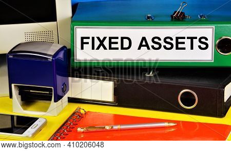Fixed Assets. Text Label On The Folder. Material Objects That Are Used For A Long Time By The Organi