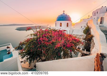 May.11.2019:  Santorini, Greece. Sunset Landscape Of Traditional Cycladic Santorini Dome With Flower