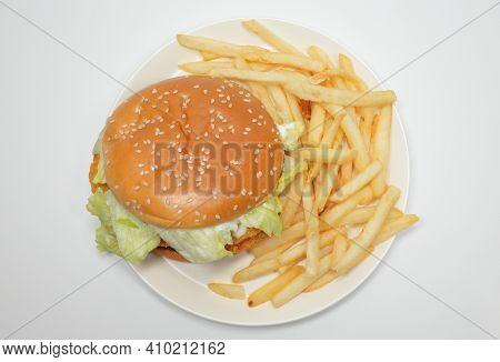 Hamburger And Potatoes On White Background