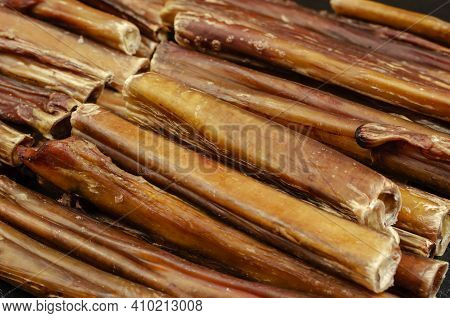 Bully Sticks For Dogs. Close-up Of Dried Chew Pet Treats. Dehydrated Bovine Penis. Beef Pizzle. Sele