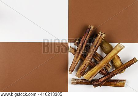 Helpful Dried Treats For Pets. Dried Bovine Penis, Bully Sticks, Beef Pizzle For Dogs On A Brown And