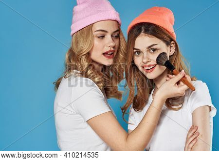 Glamorous Girlfriends In Colorful Hats Cosmetics Weekend Lifestyle Close-up