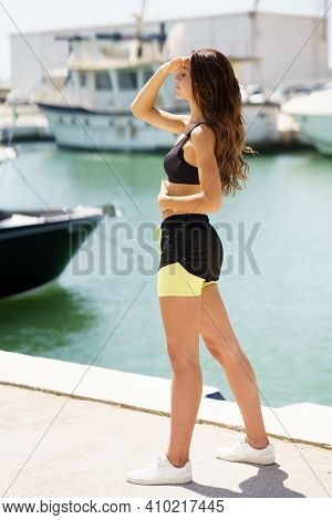 Fitness Woman In Sportswear Outfit Training On Waterfront Harbour.