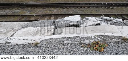 Broken Platform Near The Railway Tracks. Dangerous Platform