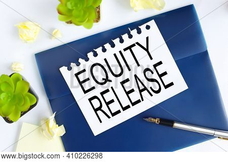 Equity Release . Text On White Notepad Paper On Blue Folder. On A Light Background Near The Crumpled
