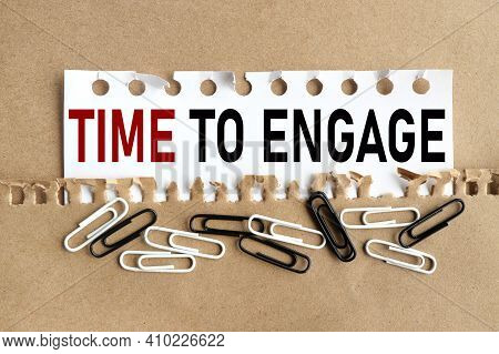 Time To Engage. Text On White Paper Over Torn Paper Background.