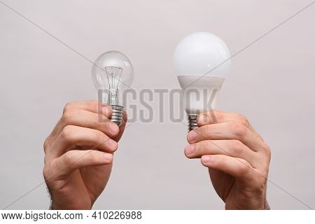 Incandescent Light Bulb And Led Light Bulb In Your Hands.