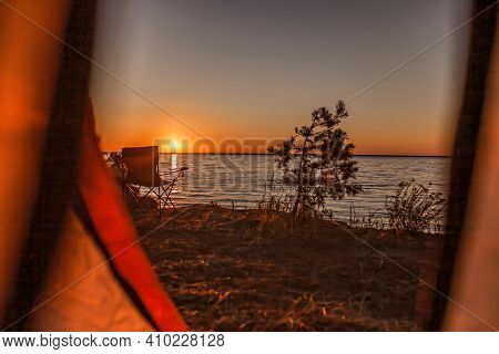 Family Summer Getaway. Beautiful Sunrise On The Wild Sea Beach At Campsite At Summer. Healthy Lifest