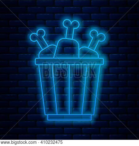 Glowing Neon Line Chicken Leg In Package Box Icon Isolated On Brick Wall Background. Chicken Drumsti