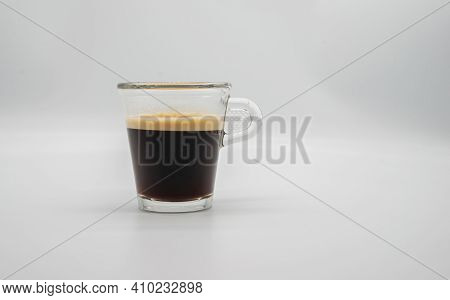 Close Up Of A Glass Of Espresso Isolated On White Background. Side View