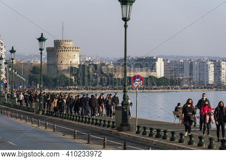 Thessaloniki, Greece - February 27 2021: People With Covid-19 Masks Before The City Landmark. Large