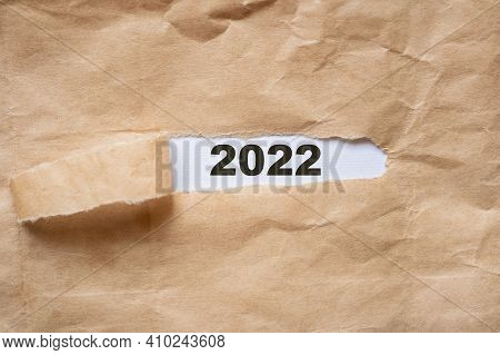 Brown Package Paper Torn To Reveal White Panel New Year 2022