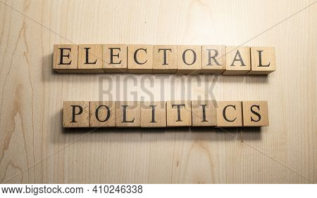 Electoral Politics Word From Wooden Cubes. Economy State Government Terms.