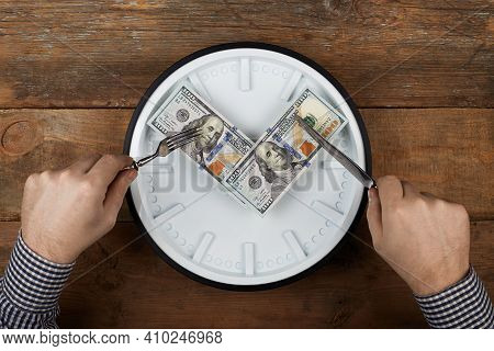 Hundred Dollars On A Clock. Cuts A Dollars