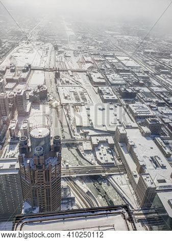 Aerial View Looking Down On The South Branch Of The Chicago River Filled With Ice After A Winter Sno
