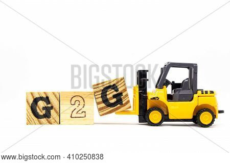 Toy Forklift Hold Letter Block G To Complete Word G2g (abbreviation Of Government To Government) On