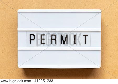Lightbox With Word Permit On Wood Background