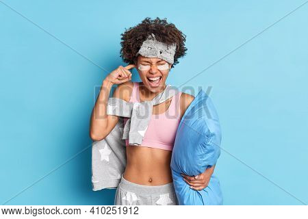 Pissed Off Afro American Woman Exclaims With Ear Shut Being Annoyed Of Disturbing Loud Noise Cannot