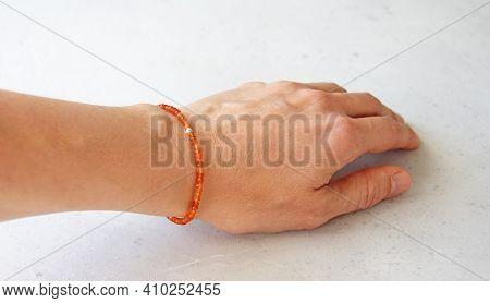 Cornelian Bracelet. A Bracelet Made Of Stones On A Hand From A Natural Stone Cornelian. Bracelet Mad