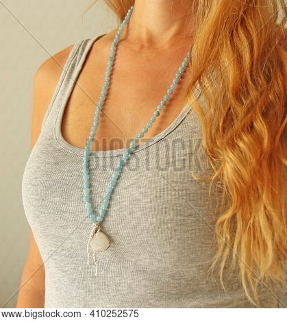 Rosary Mala 108 Beads From Natural Stones Aquamarine Are Worn On A Girl In A Grey Shirt. Author's Je