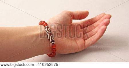 Cornelian Dzi Bead Bracelet. Bracelet Made Of Stones On Hand From Natural Stone Cornelian. Bracelet