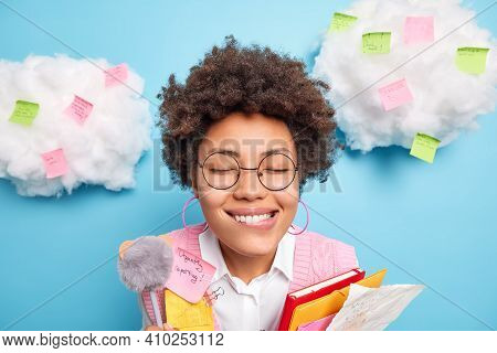 Headshot Of Cheerful Afro American Woman Surrounded With Weekly Planning Stickers At Home Office Stu