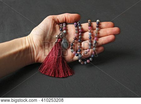 Rosary Mala 108 Beads From Natural Stones Sapphire Lie In Girl's Hand. Author's Jewelry From Natural