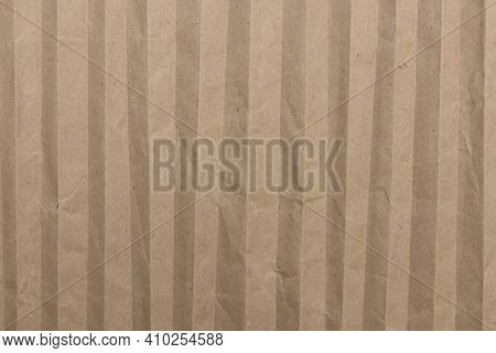 Crumpled Striped Paper Texture. Battered Cardboard Filling Background.