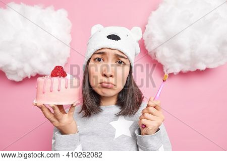 Sad Frustrated Asian Woman Has Temptation To Eat Tasty Sweet Cake But Afraids Of Having Problems Wit