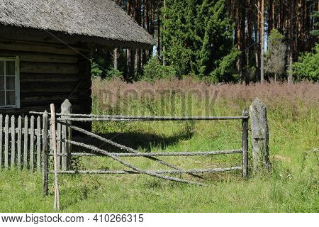 Old Partly Broken Gate And Fence Right Side Of An Old Farmstead House Opening To Back Garden What Is