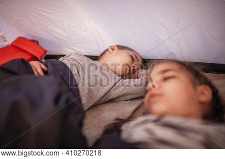 Kids Sleeping In The Camping Tent During Family Local Getaway. Children In The Sunrise Light, Overni