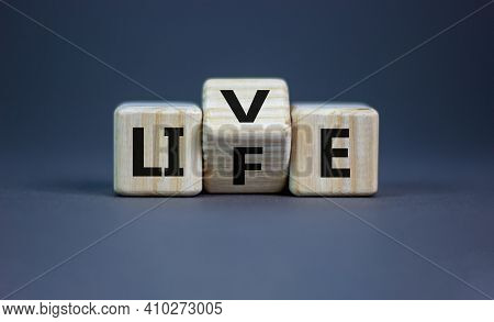 Live Your Life Symbol. Turned Cubes And Changed The Word 'live' To 'life'. Beautiful Grey Background