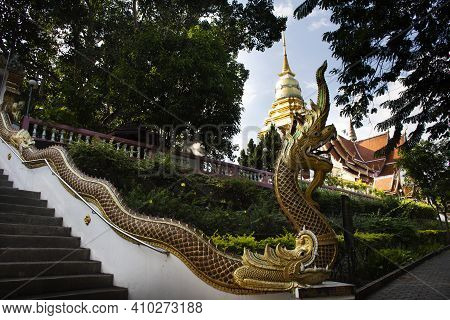 Naga Serpent Stairway And Chedi Pagoda Stupa Of Wat Phra That Doi Saket Temple For Thai People And F