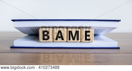 Bame Symbol. Abbreviation Bame, Black, Asian And Minority Ethnic On Wooden Cubes In Book. Beautiful